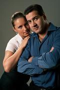 Young couple, man and woman, studio shot Kuvituskuvat