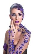 young woman with beautiful hair style and art purple make-up - stock photo