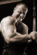 Bodybuilder training in gym Stock Photos