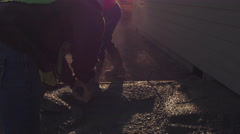 Cinematic shot of two men spreading concrete - stock footage