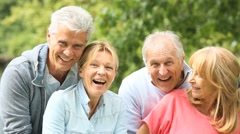 Senior couples having a good time in countryside - stock footage