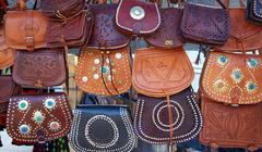 Stock Photo of Moroccan leather goods bags in a row at market