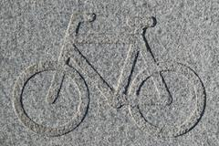Bike lane sign engraved in granite Stock Photos