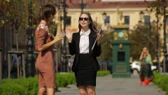 Business women with folder and tablet talking on the street, real estate agent Stock Footage