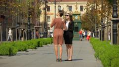 Business women with folder and tablet talking on the street, real estate agent - stock footage