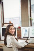 Smiling woman writing on notepad Stock Photos