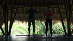 Young couple doing breathing exercise in wooden barn Stock Footage