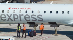 Baggage Removed from Air Canada Jazz Express Regional Jet at Airport Stock Footage
