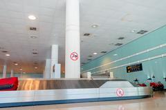 BARCELONA, SPAIN - 8 AUGUST, 2015: Conveyer belt for arrivals luggage inside - stock photo