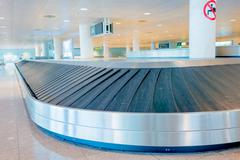 BARCELONA, SPAIN - 8 AUGUST, 2015: Conveyer belt for arrivals luggage inside Stock Photos
