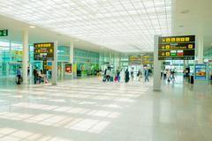 BARCELONA, SPAIN - 8 AUGUST, 2015: Inside arrivals terminal walking through Stock Photos