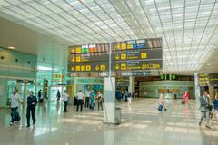 BARCELONA, SPAIN - 8 AUGUST, 2015: Inside arrivals terminal walking through Stock Photos