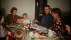 Stock Video Footage of 2540 - family & relatives sit at holiday dinner table - vintage film home movie