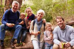 Multi-generation family eating in a forest, portrait Kuvituskuvat