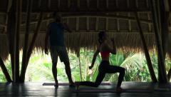 Couple in wooden barn, woman exercising and man drinking water Stock Footage