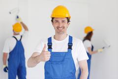 workman gives thumbs up - stock photo