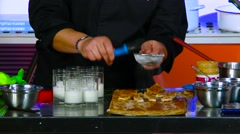 Chef puts powdered sugar Stock Footage