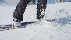 CLOSE UP: Snowboarder riding and jumping on ski slope Stock Footage