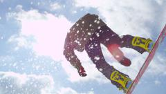 SLOW MOTION CLOSEUP: Extreme snowboarder jumping kicker in sunny winter Stock Footage