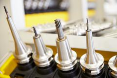 Close Up Of Precision Tools Used On CNC Machinery - stock photo