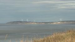 Wind Turbines by Ocean in Alaska Far Away Stock Footage