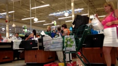 One side of check out counter inside Price Smart foods store. Stock Footage