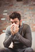 SIck Man blowing his nose Stock Photos