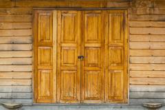 Wooden door and latch - stock photo