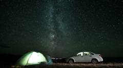 Milky way rotating above camping at night. Slider time lapse Stock Footage