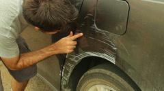 Damaged car or van looking at Stock Footage
