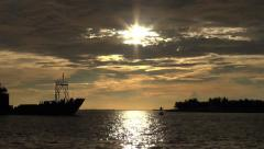 Navy ship entering Key West at sunset Stock Footage