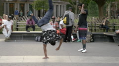 Breakdancer spinning on hand, breakdancing in Washington Square Park in NYC Stock Footage