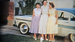 1957: 3 sisters showing off famous 57' Plymouth brand new car. Stock Footage