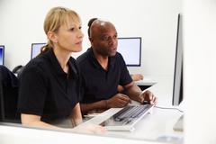 Engineers Using CAD System In Design Studio - stock photo