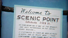 1955: Scenic point retro signs and 50s family enjoying the view. Stock Footage