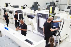 High Angle View Of Engineering Workshop With CNC Machines Stock Photos