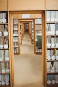 Empty aisle of college library Stock Photos
