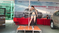 Women's dance in the car exhibition sales will, in Shenzhen, China Stock Footage