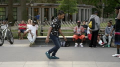 Breakdancer doing windmills on hands in Washington Square Park in NYC Stock Footage