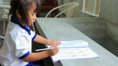 student doing school home work at home - stock footage