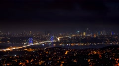 Istanbul bosphorus bridge skyline cityscape illuminated at night Stock Footage