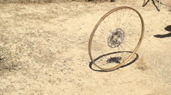 old bike wheel junk yard - stock footage