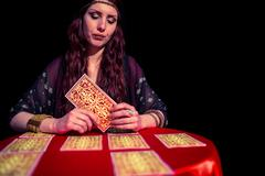 Fortune teller using tarot cards with eyes closed Stock Photos