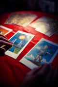 Close-up of cropped hands using tarot cards Stock Photos