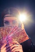 Portrait of fortune teller holding tarot cards bunch Stock Photos