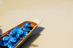 Row boat with hat Stock Photos