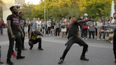 Dance crew battling, breakdancing in Washington Square Park in 4K NYC Stock Footage