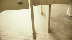 Public bathroom stall floor Stock Footage