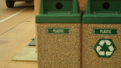 Recycling bins outside trash bin Stock Footage