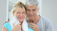 Portrait of senior couple in fitness outfit - stock footage